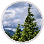 Lone Fir With Clouds Round Beach Towel