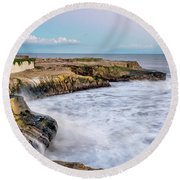 Long Exposure Of Waves Against The Cliff With Lighthouse In Shot Round Beach Towel