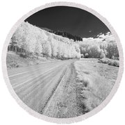 Round Beach Towel featuring the photograph Long Road In Colorado by Jon Glaser