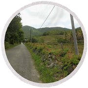 Long Road Into Colombier Round Beach Towel