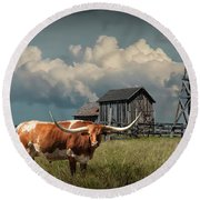 Longhorn Steer In A Prairie Pasture By Windmill And Old Gray Wooden Barn Round Beach Towel