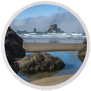 Low Tide At Ecola Round Beach Towel
