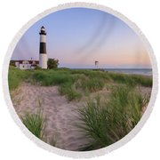 Round Beach Towel featuring the photograph Ludington Beach And Big Sable Point Lighthouse by Adam Romanowicz