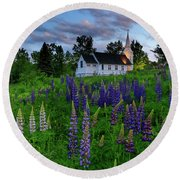 Lupines By The Church Round Beach Towel