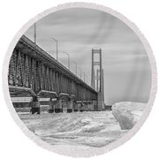 Round Beach Towel featuring the photograph Mackinac Bridge Icy Black And White  by John McGraw