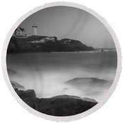 Round Beach Towel featuring the photograph Maine Cape Neddick Lighthouse And Rocky Coastal Waves Bw by Ranjay Mitra