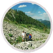 Man And Llama Packing Over A High Alpine Mountain Pass Round Beach Towel by Jerry Voss