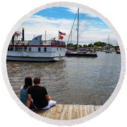 Man And Woman Sitting On The Dock Round Beach Towel