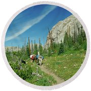 Man Hiking With Two Llamas High Alpine Mountain Trail Round Beach Towel