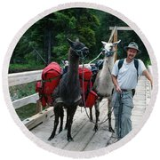 Man Posing With Two Llamas On Wilderness Drawbridge Round Beach Towel