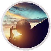 Man Rolling Huge Concrete Ball Up Hill Round Beach Towel