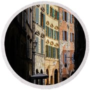 Man Walking Alone In Small Street In Siena, Tuscany, Italy Round Beach Towel
