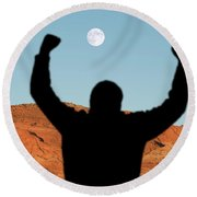 Man With Raised Arms In Desert Canyon Round Beach Towel