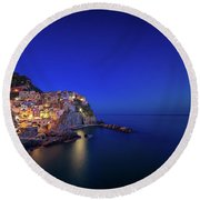 Round Beach Towel featuring the photograph Manarola Village During Blue Hour At Night by IPics Photography