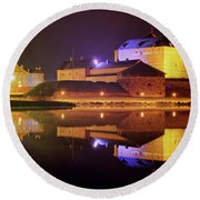 Medieval Castle By The Lake At Night Round Beach Towel