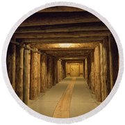 Round Beach Towel featuring the photograph Mining Tunnel by Juli Scalzi