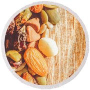 Mixed Nuts On Wooden Background Round Beach Towel
