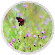 Round Beach Towel featuring the photograph Monarch Butterfly In Flight Over The Wildflowers by Kerri Farley