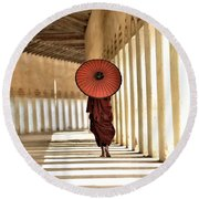 Monk With Umbrella Walking In Th Light Passway Round Beach Towel