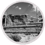 Round Beach Towel featuring the photograph Fence In Monument Valley - Bw by Dany Lison