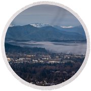 Morning Fog Over Grants Pass Round Beach Towel by Mick Anderson