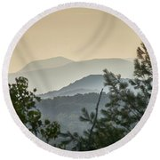 Mountains In The Distance Round Beach Towel