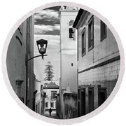 Narrow Street And Bell Tower In Tavira - Portugal Round Beach Towel