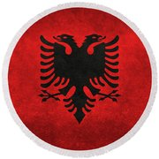 Round Beach Towel featuring the digital art National Flag Of Albania With Distressed Vintage Treatment  by Bruce Stanfield