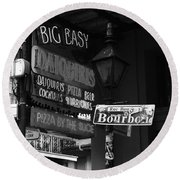 Neon Sign On Bourbon Street Corner French Quarter New Orleans Black And White Round Beach Towel by Shawn O'Brien
