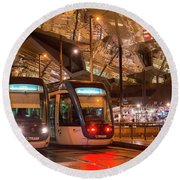 Night View Of Two Trams At Glories Station  Round Beach Towel