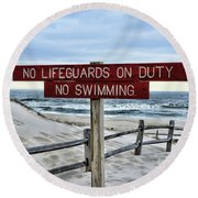 Round Beach Towel featuring the photograph No Lifeguards On Duty by Paul Ward