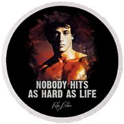 Nobody Hits As Hard As Life Round Beach Towel