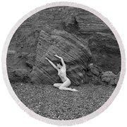 Nude Woman Pulling Shape By Rocks Round Beach Towel