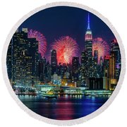 Round Beach Towel featuring the photograph Nyc Fireworks Celebration by Susan Candelario