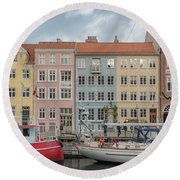 Round Beach Towel featuring the photograph Nyhavn Waterfront In Copenhagen by Antony McAulay