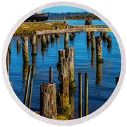 Old Boat And Pier Posts Round Beach Towel