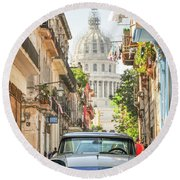 Old Car And El Capitolio Round Beach Towel