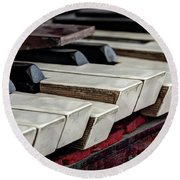 Round Beach Towel featuring the photograph Old Organ Keys by Michal Boubin