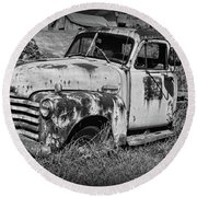 Round Beach Towel featuring the photograph Old Rusty Chevy In Black And White by Paul Ward