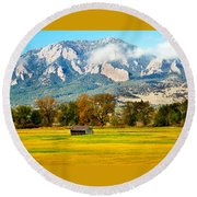 old shed against Flatirons Round Beach Towel