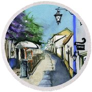 Round Beach Towel featuring the painting Old Street In Obidos, Portugal by Dora Hathazi Mendes