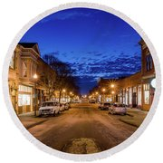 Old Town Evening Round Beach Towel by Greg Nyquist