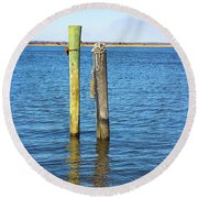 Round Beach Towel featuring the photograph Old Wood Pilings In Blue Water by Colleen Kammerer