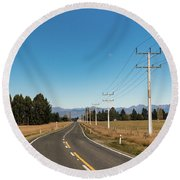 Round Beach Towel featuring the photograph On The Road by Gary Eason