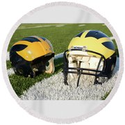 One Old, One New Wolverine Helmets On The Field Round Beach Towel