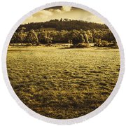 Open Fields Of Woodstock Tasmania Round Beach Towel