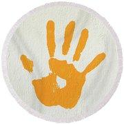 Orange Handprint On A Wall Round Beach Towel