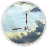 Osprey Flying In Clouds At Sunset With Fish In Talons Round Beach Towel