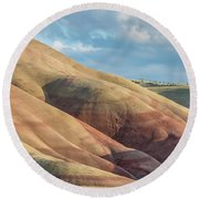 Round Beach Towel featuring the photograph Painted Hill And Clouds by Greg Nyquist