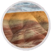 Painted Hill At Last Light Round Beach Towel by Greg Nyquist